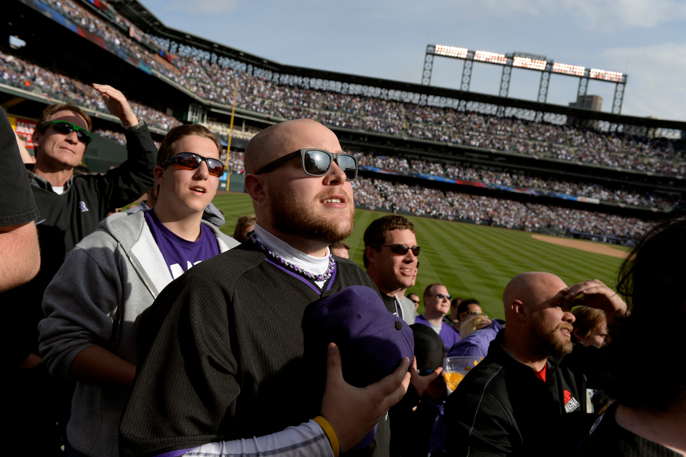 . DENVER, CO. - APRIL 04: Scott Bunker, of Denver, holds his hat to his heart during God Bless America at the Colorado Rockies home opener against the Arizona Diamondbacks at Coors Field in Denver, CO April 04, 2014. (Photo By Craig F. Walker / The Denver Post)