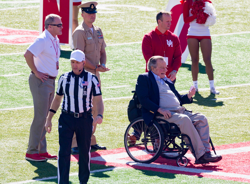 President George H. W. Bush will toss the coin.  UH wins the toss ...
