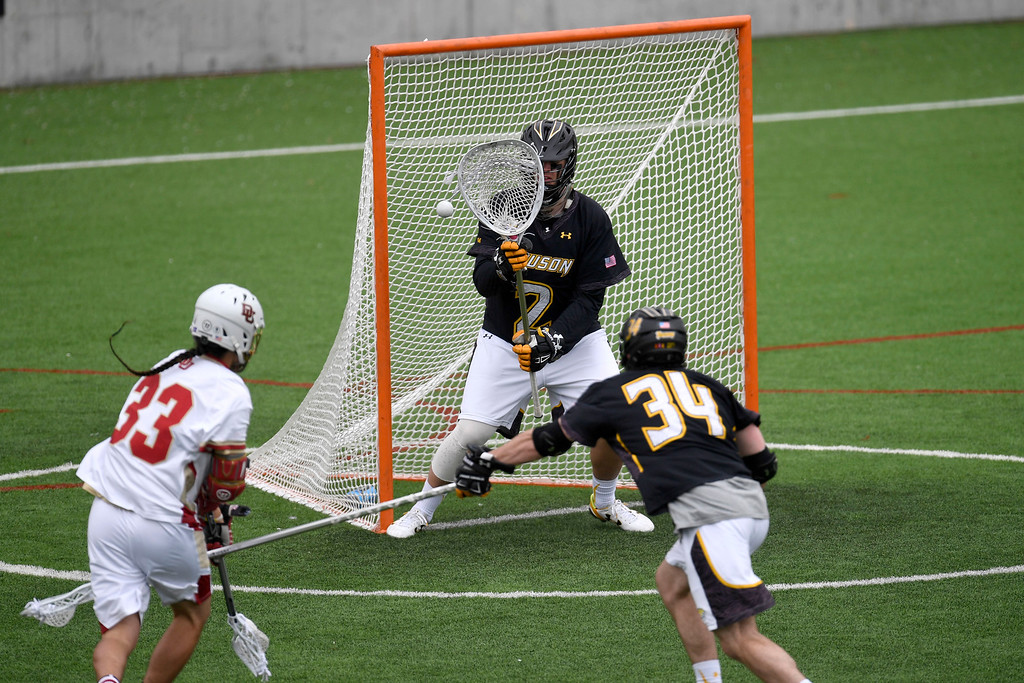 . DENVER, CO - MAY 15:  Tyler White (2) of the Towson stops a late shot attempt by  Zach Miller (33) of the Denver during the first half. University of Denver hosted Towson University in an NCAA tournament game on Sunday, May 15, 2016. (Photo by AAron Ontiveroz/The Denver Post)