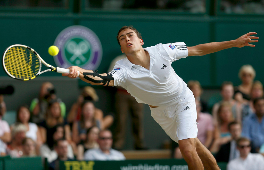 . Jerzy Janowicz of Poland hits a return to Andy Murray of Britain during their men\'s semi-final tennis match at the Wimbledon Tennis Championships, in London July 5, 2013.   REUTERS/Stefan Wermuth