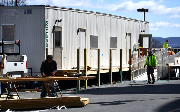 4/4/2020 Mike Orazzi | StaffnWork continues on the COVID-19 trailer for patient triage Saturday at the The Hospital of Central Connecticut in New Britain.