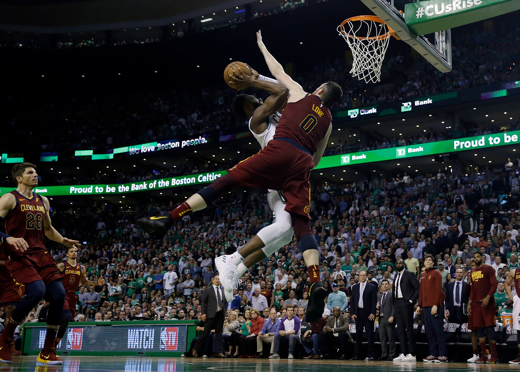 . Boston Celtics guard Jaylen Brown, rear, drives against the defense of Cleveland Cavaliers center Kevin Love during the second half in Game 2 of the NBA basketball Eastern Conference finals, Tuesday, May 15, 2018, in Boston. (AP Photo/Charles Krupa)