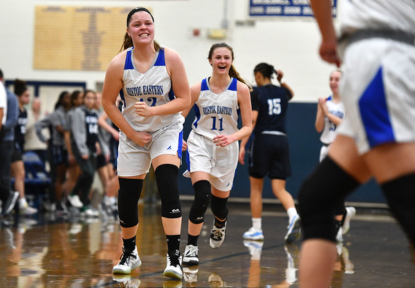 2/18/2020 Mike Orazzi | StaffrBristol Eastern's Avery Arbuckle (25) and (11) celebrate a 57-52 Eastern overtime win over East Catholic in Bristol Tuesday afternoon.