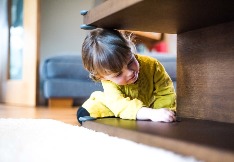 Fred_Home_Safety_Corner_Protector_Lifestyle_girl_under_table.jpg