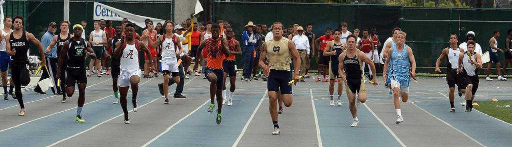 . Notre Dame\'s Koa Farmer runs the final leg of the division 3 4x100 meter race as Notre Dame won the race during the CIF Southern Section track and final Championships at Cerritos College in Norwalk, Calif., Saturday, May 24, 2014.   (Keith Birmingham/Pasadena Star-News)