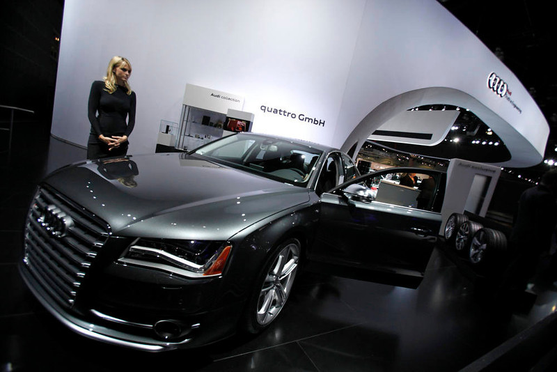 . A hostess stands next to a 2013 Audi S8 at the 2012 Los Angeles Auto Show in Los Angeles, California November 28, 2012.  REUTERS/Mario Anzuoni