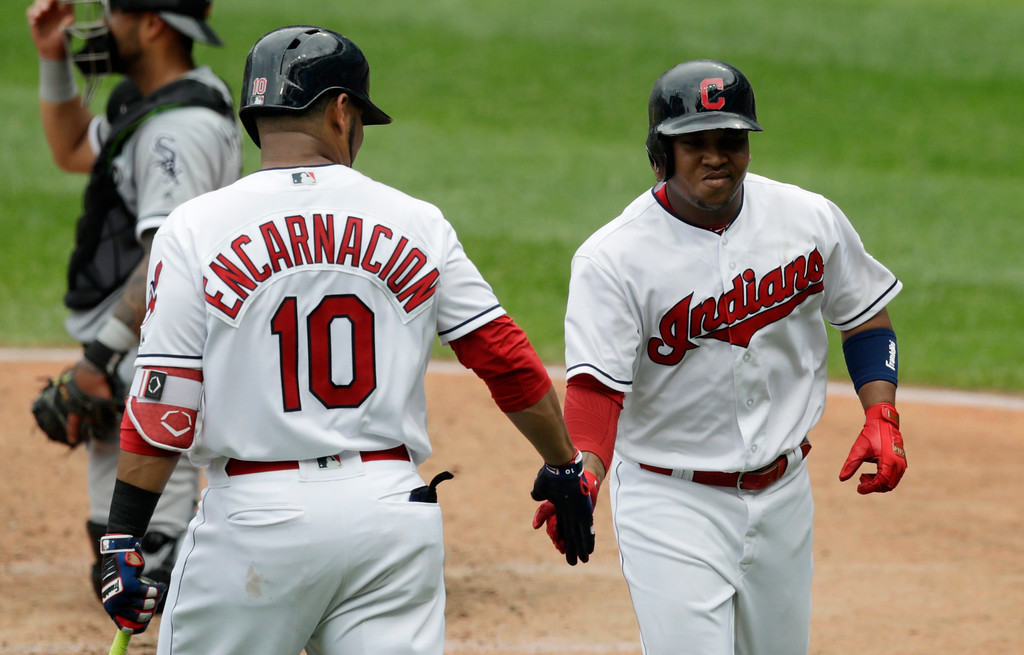 . Cleveland Indians\' Jose Ramirez, right, is congratulated by Edwin Encarnacion after Ramirez hit a solo home run off Chicago White Sox relief pitcher Chris Volstad in the fourth inning of a baseball game, Wednesday, May 30, 2018, in Cleveland. (AP Photo/Tony Dejak)