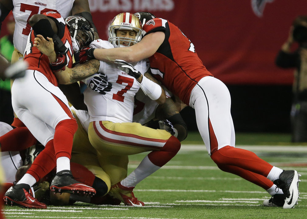 Description of . San Francisco 49ers\' Colin Kaepernick (7) is sacked by Atlanta Falcons\' Stephen Nicholas and Kroy Biermann during the first half of the NFL football NFC Championship game Sunday, Jan. 20, 2013, in Atlanta. (AP Photo/John Bazemore)