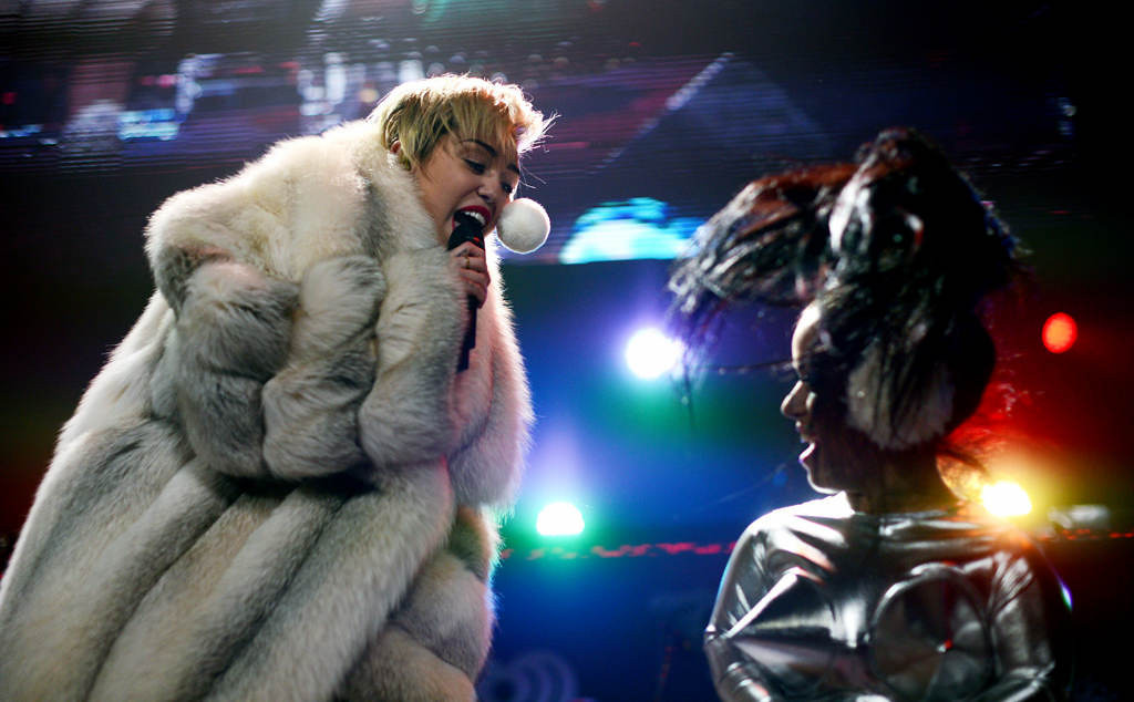 ". Miley Cyrus sings ""Party in the USA\""  with Hollis Jane, right, at Xcel Energy Center in St. Paul, Tuesday, December 10, 2013. (Pioneer Press: Chris Polydoroff)"