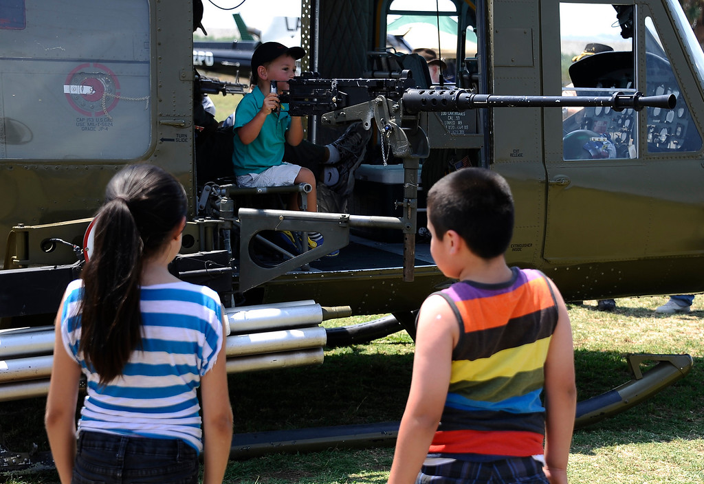 . Kids get up close to check out 50 caliber machine gun during the 20th anniversary of American Heroes Air Show Courage at the Speed of Flight at Hansen Dam. Lake View Terrace CA.  June 29,2013. Photo by Gene Blevins/LA Daily News