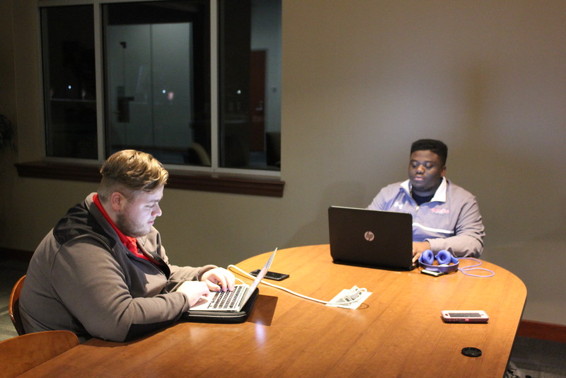 Students Alec Guerra and Brian White trying to finish work before Thanksgiving Break