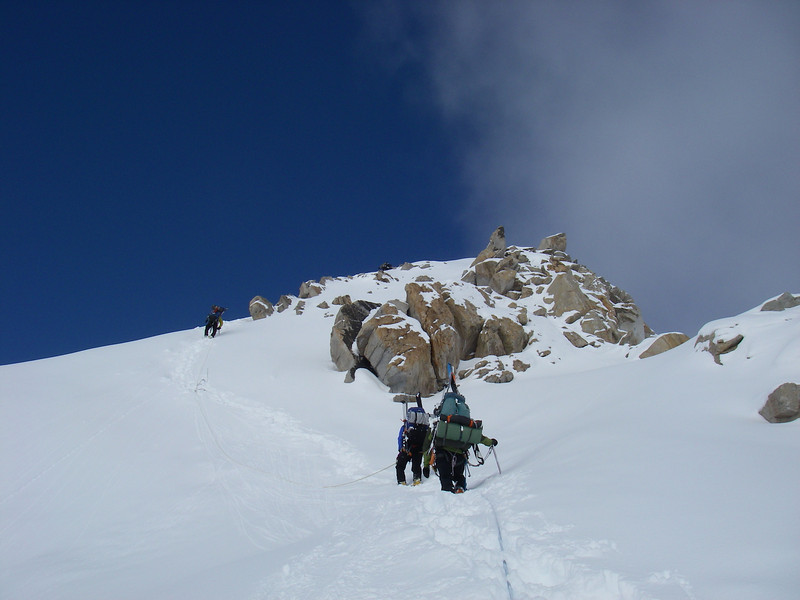 Much better weather on the ridge towards C4. John DM above John W, and Durny.