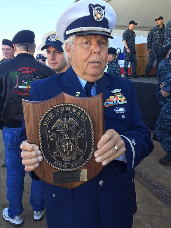 . Submitted <br> Joe Muharsky was awarded  plaque with ships coat of arms on it by Captain James Kirk.