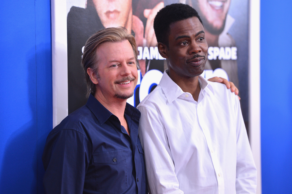 ". Actor David Spade (L) and comedian Chris Rock attend the ""Grown Ups 2\"" New York Premiere at AMC Lincoln Square Theater on July 10, 2013 in New York City.  (Photo by Stephen Lovekin/Getty Images)"