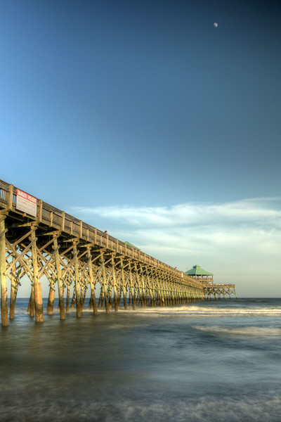 Waves roll beneath the Edwin S. Taylor Fishing Pier in Folly Beach, SC on Monday, July 7, 2014. Copyright 2014 Jason Barnette