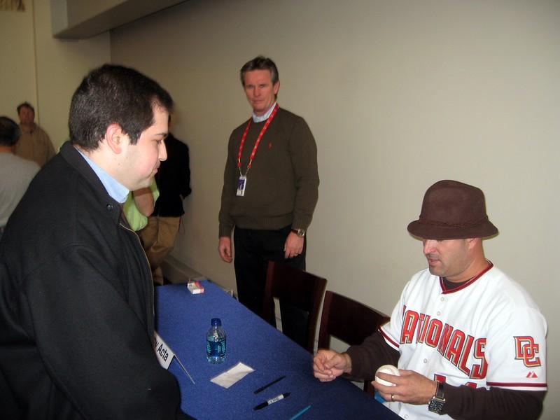 Nationals manager Manny Acta autographs a baseball for Craig