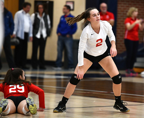 11/7/2019 Mike Orazzi | StaffrConard High School's Eileen Droney (29) and Fallon Moore (2) during the CCC girls volleyball tournament at Avon High School on Thursday. rr