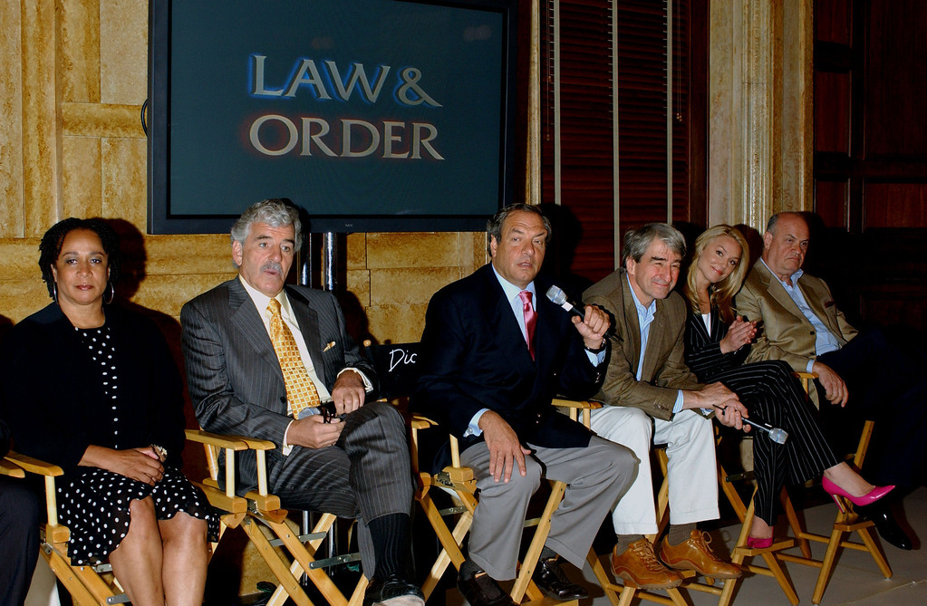 . S. Epatha Merkerson, Dennis Farina, Dick Wolf, Sam Waterston, Elisabeth Rohm and Fred Thompson answer questions during a press conference welcoming Dennis Farina to Law and Order on September 14, 2004 in New York City.  (Photo by Trish Lease/Getty Images)