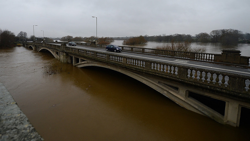 . Vehicles are driven across a bridge over the swollen River Severn at Atcham near Shrewsbury on December 24, 2012. Heavy flooding across parts of Britain caused widespread road and rail disruption, wreaking havoc on Christmas travel plans while rescuers worked to evacuate people from the hardest-hit communities. ANDREW YATES/AFP/Getty Images
