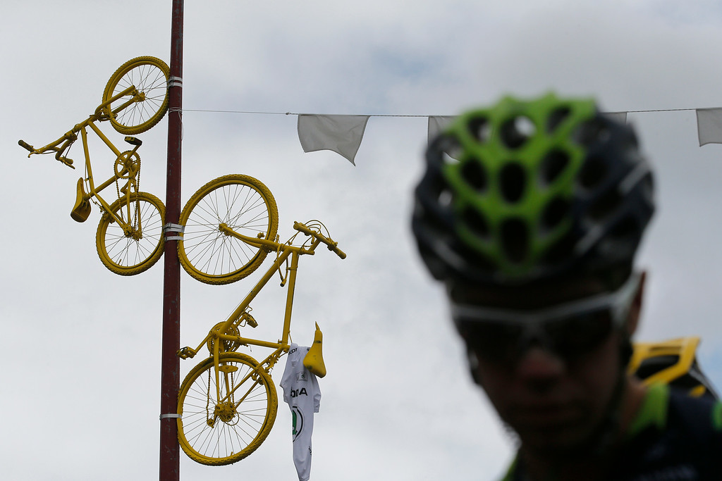 . Decorated bicycles hang from a lamppost as riders arrive for the start of the ninth stage of the Tour de France cycling race over 170 kilometers (105.6 miles) with start in Gerardmer and finish in Mulhouse, France, Sunday, July 13, 2014. (AP Photo/Christophe Ena)