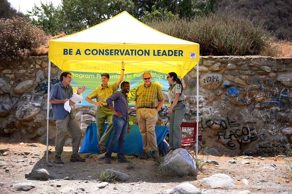. The Urban Conservation Corps educates people visiting the East Fork of the San Gabriel River in the Angeles National Forest Saturday, July 20, 2013. Although the Urban Conservation Corps says their river trash count studies show less trash the area is still littered with garbage. (SGVN/Staff Photo by Sarah Reingewirtz)