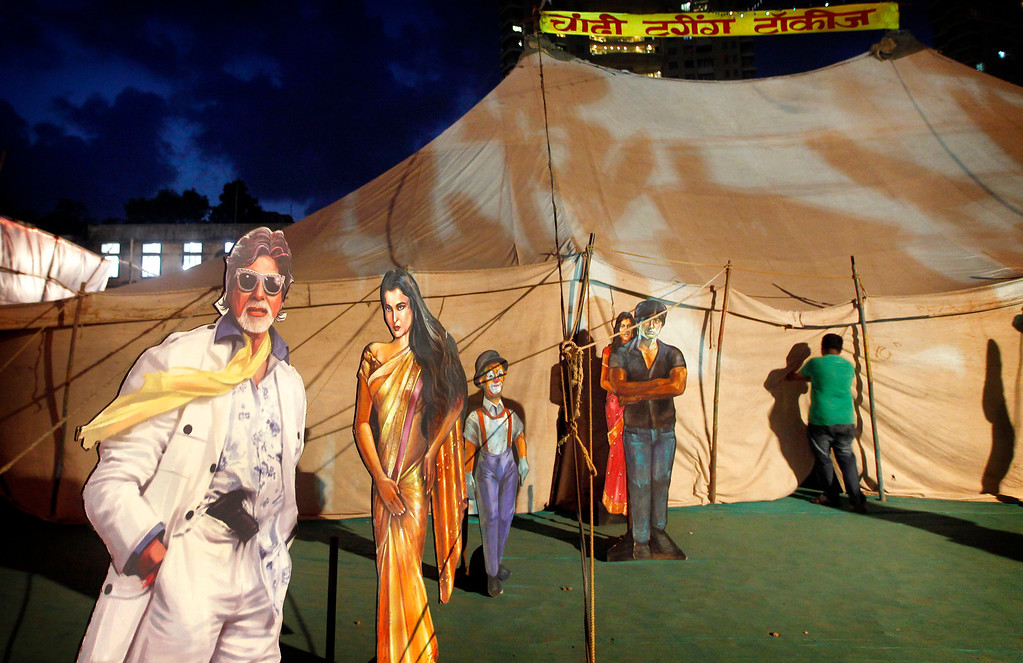 """. In this April 20, 2013 photo, cut outs of Indian Bollywood stars are displayed on the premises of the Anup Touring Talkies tent cinema in Mumbai, India. Friday, May 3 marks exactly a hundred years after India\'s first feature film \""""Raja Harischandra,\"""" a silent movie, was screened in 1913. India produced almost 1,500 movies last year and the industry is expected to grow from $ 2 billion to $ 3.6 billion in the next five years, according to consultancy KPMG. (AP Photo/Rajanish Kakade)"""