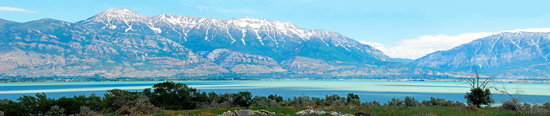 2011/7/6 – I've always wanted to drive around to the west side of Utah Lake and shoot back towards my home. Our home is just right of center in the image. This is a four photo panorama that covers about 140 degrees from the north to the south. Normally the lake looks green from algae growth, but today it picked up the blue of the sky and actually made the water look inviting.