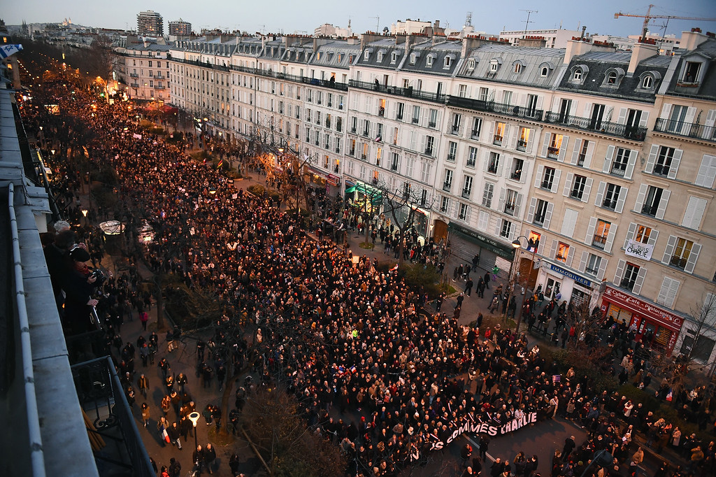 . PARIS, FRANCE - JANUARY 11:  Thousands of people make their way down Boulevard Voltaire,from Place de la Republique on route to Place de la Nation, following the recent terrorist attacks on January 11, 2015 in Paris, France. An estimated one million people have converged in central Paris for the Unity March joining in solidarity with the 17 victims of this weeks terrorist attacks in the country. French President Francois Hollande led the march and was joined by world leaders in a sign of unity. The terrorist atrocities started on Wednesday with the attack on the French satirical magazine Charlie Hebdo, killing 12, and ended on Friday with sieges at a printing company in Dammartin en Goele and a Kosher supermarket in Paris with four hostages and three suspects being killed. A fourth suspect, Hayat Boumeddiene, 26, escaped and is wanted in connection with the murder of a policewoman.  (Photo by Jeff J Mitchell/Getty Images)