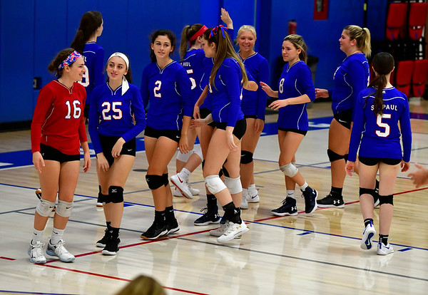 10/11/2019 Mike Orazzi | Staff St. Paul girls during Thursday night's girls volleyball with Torrington in Bristol.