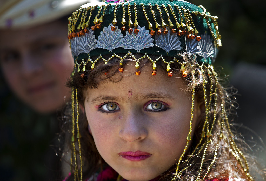 . A Pakistani internally displaced girl Amina Bibi attends class at a school rebuilt by the Pakistani army, in Tank, the bordering town of South Waziristan, the Pakistani tribal area bordering Afghanistan, March 28, 2013. (AP Photo/B.K. Bangash)