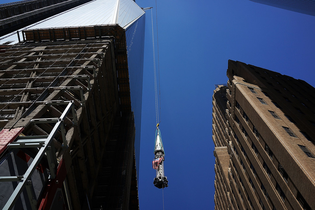 . The 408-foot spire is viewed as it is hoisted onto a temporary platform on the top of One World Trade Center on May 2, 2013 in New York City. When bolted into place at a later date, the spire will make One World Trade Center the tallest building in the Western Hemisphere.The raising of the spire, which comes on the second anniversary of the death of Osama bin Laden, will make One World Trade Center 1,776 feet tall. One World Trade Center is built on the site where the September 11, 2001 attacks toppled the original World Trade Center towers.  (Photo by Spencer Platt/Getty Images)