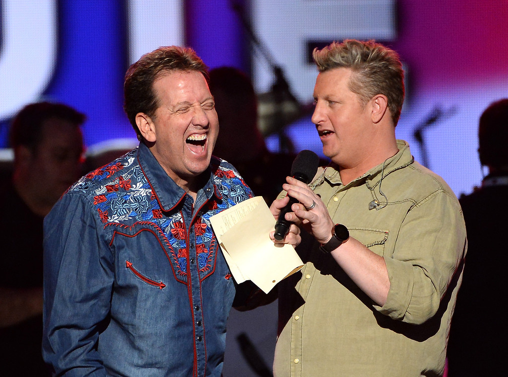 . Entertainer Shawn Parr (L) and singer Gary LeVox of Rascal Flatts speak onstage during ACM Presents: An All-Star Salute To The Troops at the MGM Grand Garden Arena on April 7, 2014 in Las Vegas, Nevada.  (Photo by Ethan Miller/Getty Images for ACM)