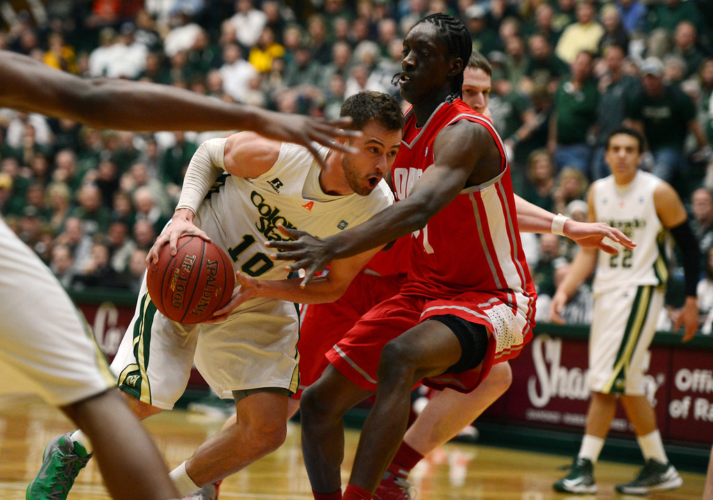. Fort COLLINS, CO. - FEBRUARY 23: Colorado State Wes Eikmeier drives to the basket against New Mexico Tony Snell during first half action at Moby Arena in Fort Collin, CO February  24, 2013. The Colorado State Rams lost to the New Mexico Lobos 91-82. (Photo By Craig F. Walker/The Denver Post)