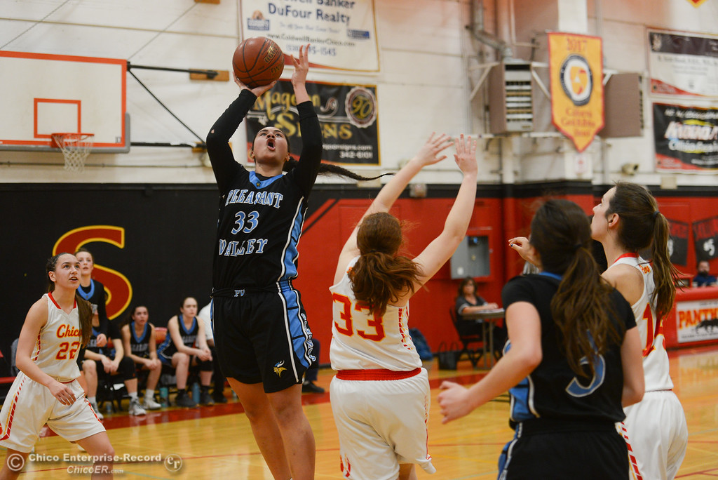 . Pleasant Valley\'s Sirena Tuitele (33) goes up for a shot against Chico High\'s Rachel Digmon (33), Thursday, February 8, 2018, in Chico, California. (Carin Dorghalli -- Enterprise-Record)