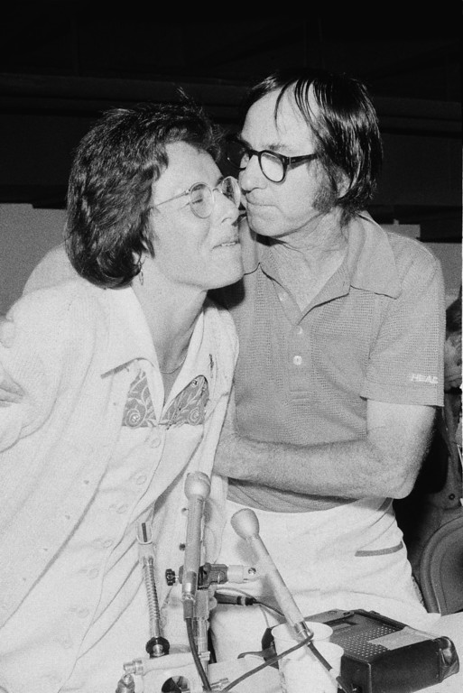 . Bobby Riggs, right, leans over to plant a kiss on Billie Jean King after Ms. King set Riggs down 6-4; 6-3; 6-3 in their $100,000 winner-take-all tennis match in the Astrodome in Houston, Tex., Thursday, Sept. 21, 1973. (AP Photo)