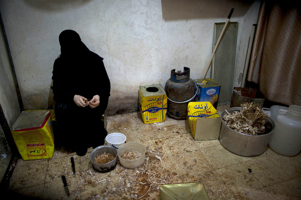 . A Syrian woman cooks an Iftar meal for poor people during the second day of the Muslim holy month of Ramadan in the Bustan al-Qasr district of Aleppo on July 11, 2013. Syria\'s ruling Baath party has replaced its top leadership in a surprise move, while UN head Ban Ki-Moon called on all parties in the war to observe a truce during the Muslim holy month of Ramadan. JM LOPEZ/AFP/Getty Images