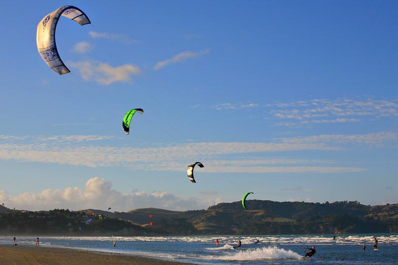 Symmetrical kite surfers at Orewa near Auckland