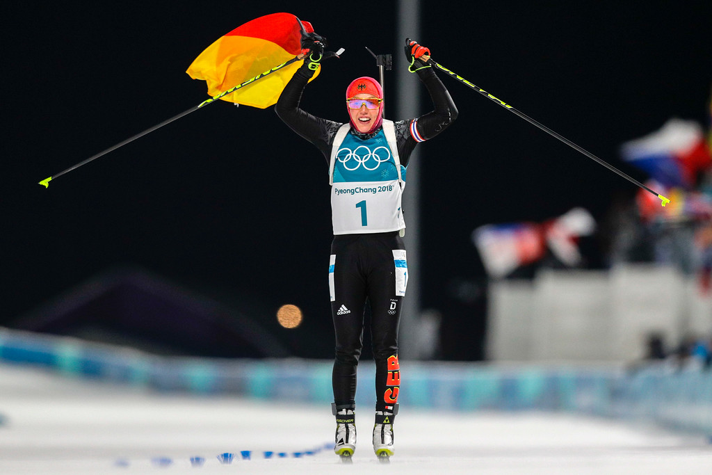 . Laura Dahlmeier, of Germany, crosses the finish line to win the gold medal in the women\'s 10-kilometer biathlon pursuit at the 2018 Winter Olympics in Pyeongchang, South Korea, Monday, Feb. 12, 2018. (AP Photo/Andrew Medichini)