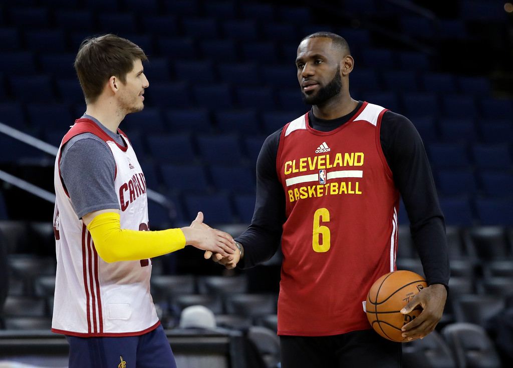 . Cleveland Cavaliers\' LeBron James, right, shakes hands with teammate Kyle Korver during an NBA basketball practice, Wednesday, May 31, 2017, in Oakland, Calif. The Cavaliers face the Golden State Warriors in Game 1 of the NBA Finals on Thursday in Oakland. (AP Photo/Marcio Jose Sanchez)