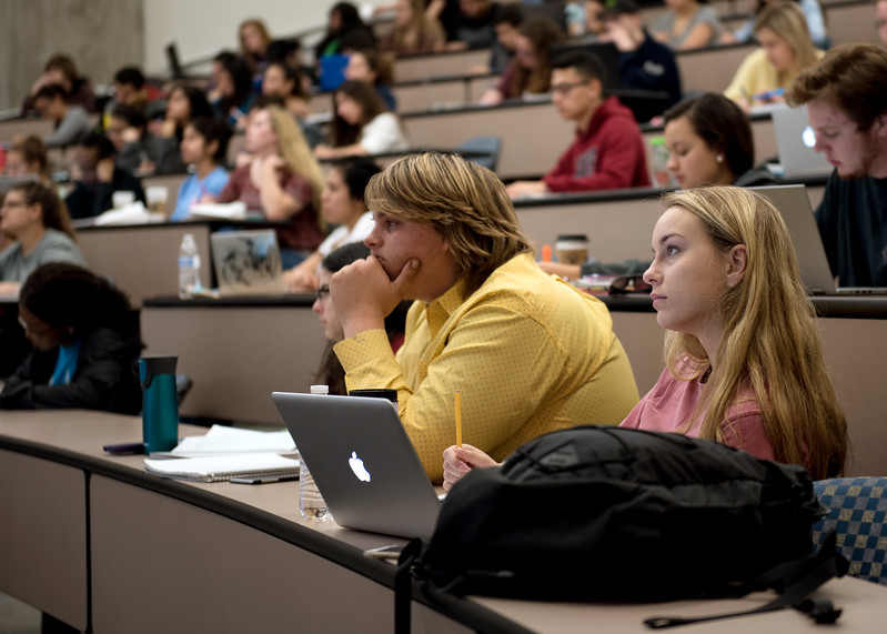 Students Troy Kvenstler(left) and Erin Pharr are deeply drawn to the professor's lecture.