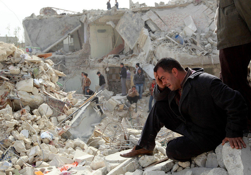 ". A man cries at a site hit by what activists said was a Scud missile in Aleppo\'s Ard al-Hamra neighborhood, in this February 23, 2013 file photo. The United States believes with varying degrees of confidence that Syria\'s regime has used chemical weapons on a small scale, the White House said on Thursday. But it added that President Barack Obama needed ""credible and corroborated\"" facts before acting on that assessment  REUTERS/Muzaffar Salman/Files"