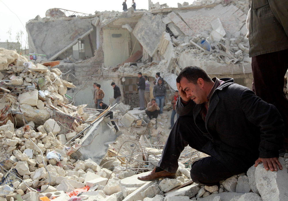 """. A man cries at a site hit by what activists said was a Scud missile in Aleppo\'s Ard al-Hamra neighborhood, in this February 23, 2013 file photo. The United States believes with varying degrees of confidence that Syria\'s regime has used chemical weapons on a small scale, the White House said on Thursday. But it added that President Barack Obama needed \""""credible and corroborated\"""" facts before acting on that assessment  REUTERS/Muzaffar Salman/Files"""