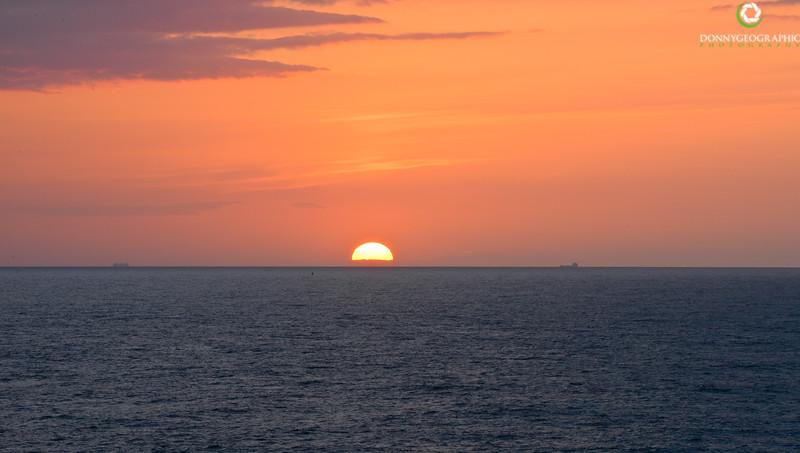 Sun setting & ships on the horizon.jpg