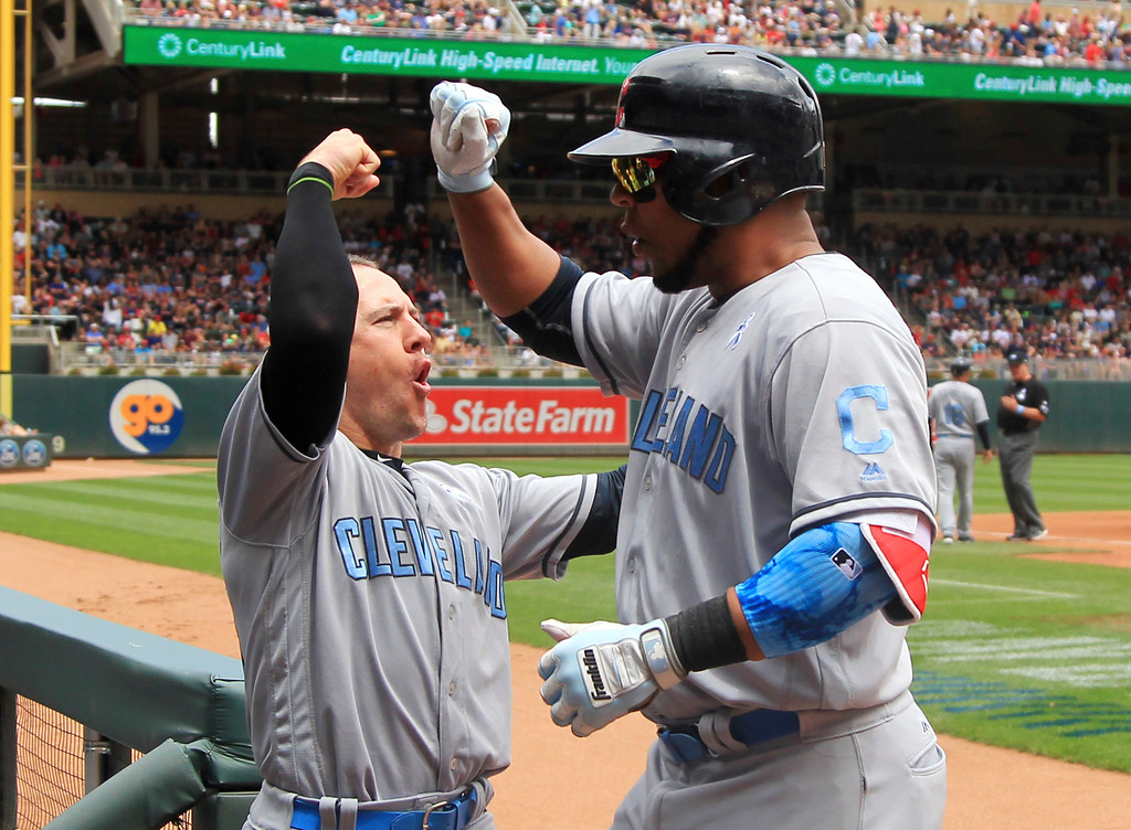 . CORRECTS TO ENCARNACION NOT INCARNACION - Cleveland Indians\' Edwin Encarnacion, right, is congratulated by teammate Daniel Robertson after hitting a home run in the third inning of a baseball game against the Minnesota Twins, Sunday, June 18, 2017, in Minneapolis. (AP Photo/Andy Clayton-King)