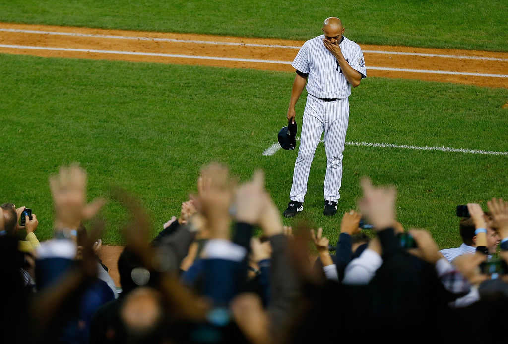 . Mariano Rivera #42 of the New York Yankees waves to the crowd after leaving the game against the Tampa Bay Rays in the ninth inning at Yankee Stadium on September 26, 2013 in the Bronx borough of New York City.  (Photo by Mike Stobe/Getty Images)