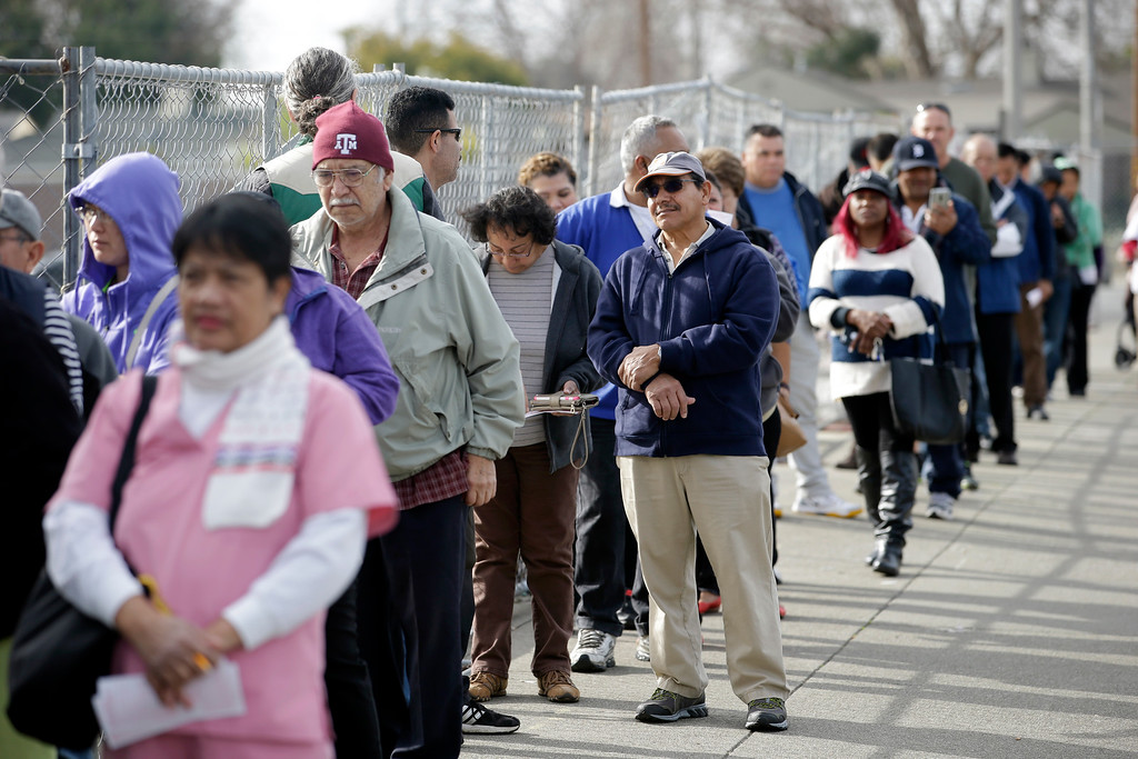 . People line up to buy Powerball lottery tickets at Kavanagh Liquors Tuesday, Jan. 12, 2016, in San Lorenzo, Calif. The Powerball jackpot has grown to over $1 billion dollars for the drawing Wednesday.  (AP Photo/Marcio Jose Sanchez)