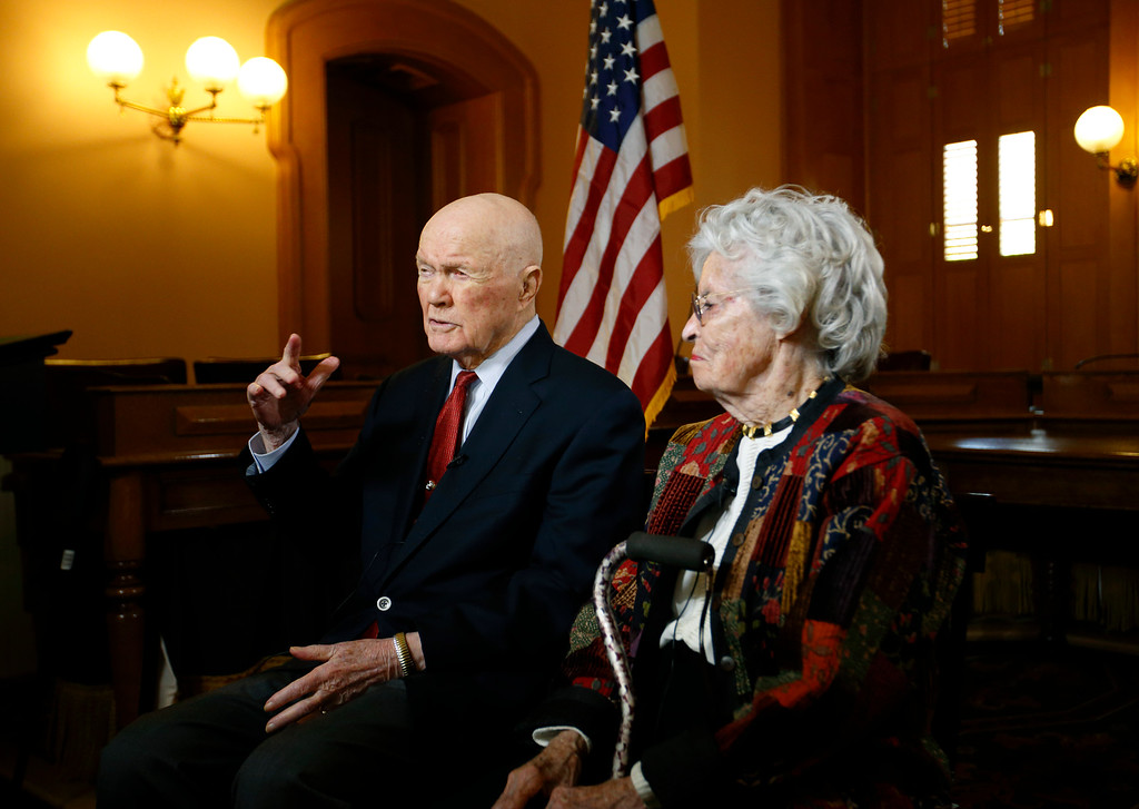 ". In this photo taken on Thursday, May 14, 2015, former astronaut and senator John Glenn, left, answers questions with his wife Annie during an exclusive interview with The Associated Press at the Ohio Statehouse. Glenn said facts about scientific discovery should be taught in schools - and that includes evolution. The 93-year-old said that he sees no contradiction between believing in God and believing in evolution. When he went back into space in 1998, he had announced that ""to look out at this kind of creation out here and not believe in God is to me impossible.�   (AP Photo/Paul Vernon)"