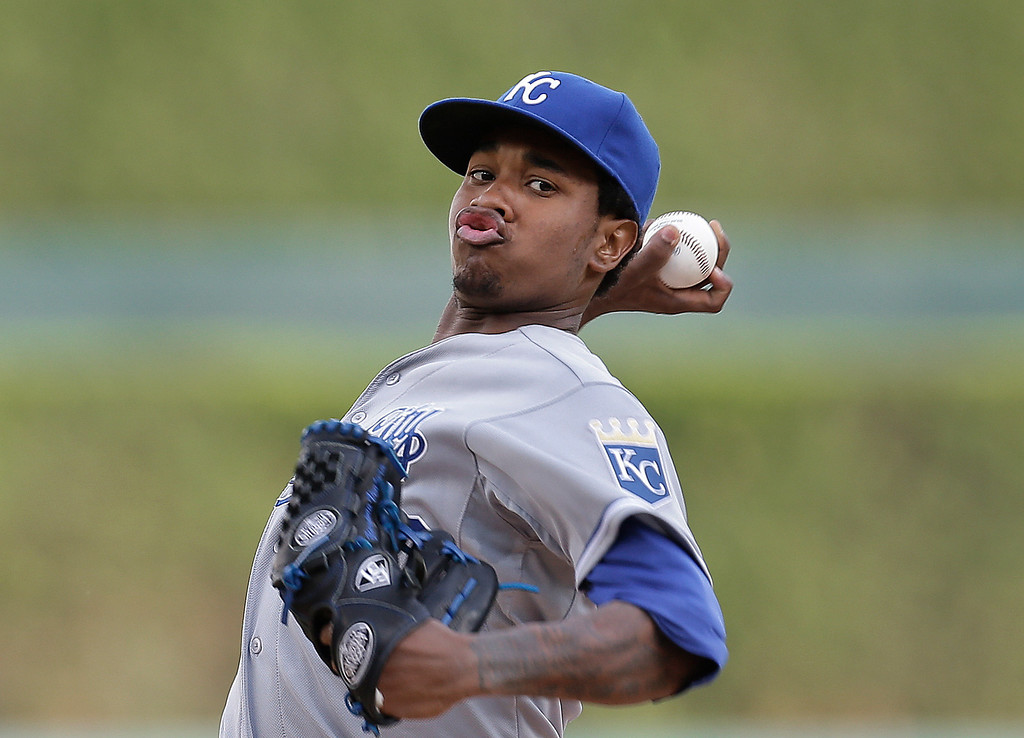 . Kansas City Royals pitcher Yordano Ventura throws a warmup pitch against the Detroit Tigers in the first inning of a baseball game in Detroit, Tuesday, June 17, 2014.  (AP Photo/Paul Sancya)