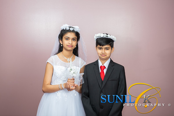 Riya and Rex Vadathala Holy Communion