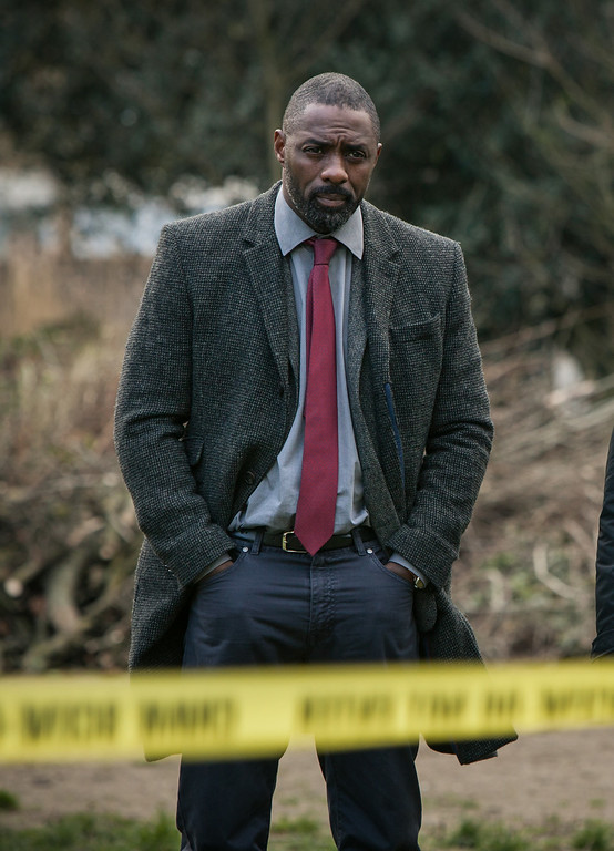 """. This image released by BBC America shows Idris Elba in a scene from \""""Luther.\"""" Elba was nominated for an Emmy Award for best actor in a miniseries or movie on Thursday, July 10, 2014. The 66th Primetime Emmy Awards will be presented Aug. 25 at the Nokia Theatre in Los Angeles. (AP Photo/BBC America, Rober Viglasky)"""